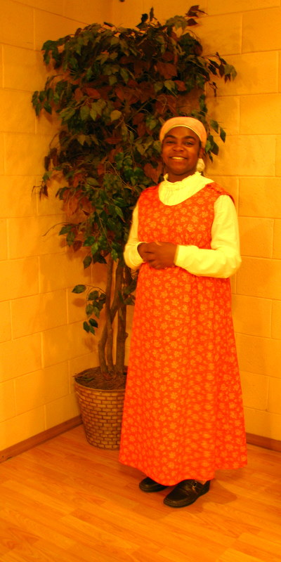 Sis Latosha Makes Orange Jumper.JPG